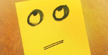 Confused face on a post it note.
